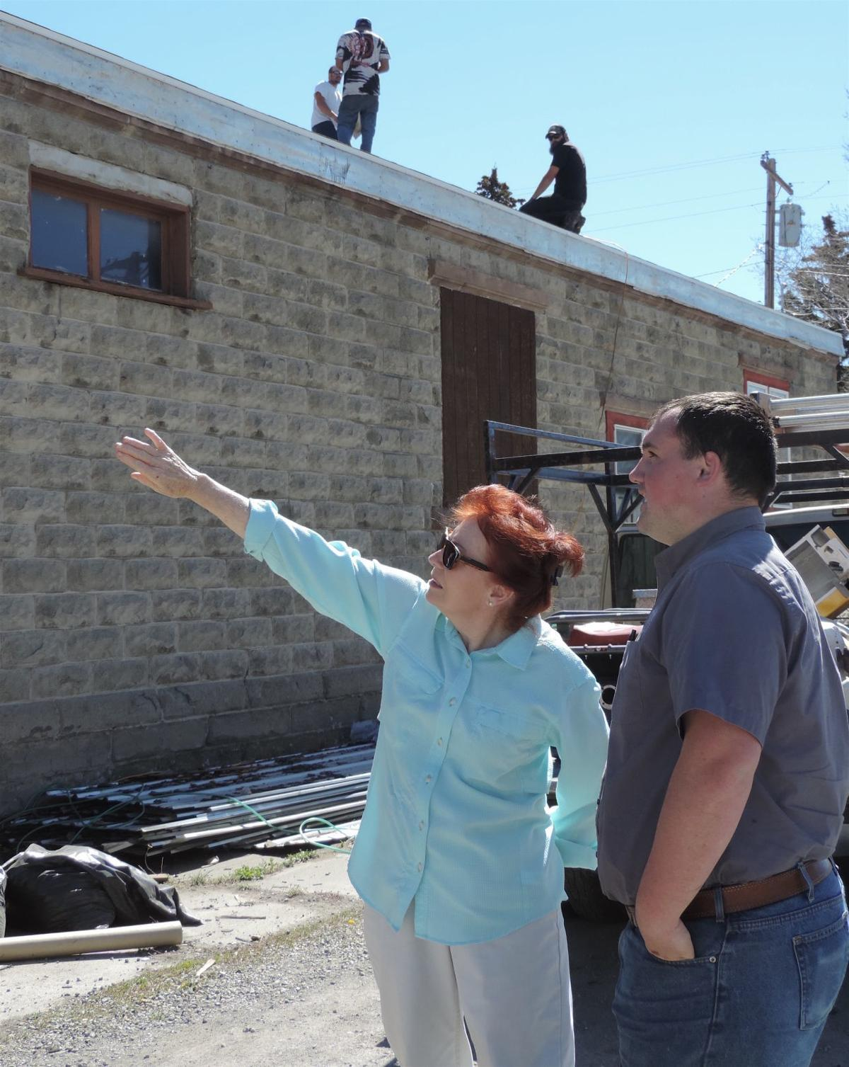 margie van orden discusses roof with tim rice