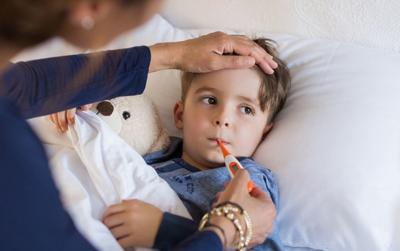 Child sick with flu stock image