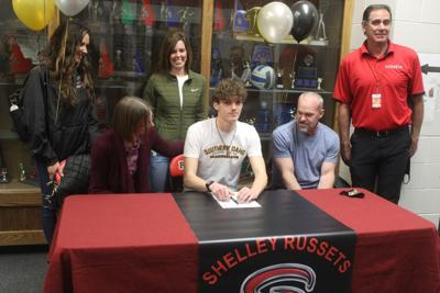 Ben Vernon of Shelley High School signing letter of intent to CSI