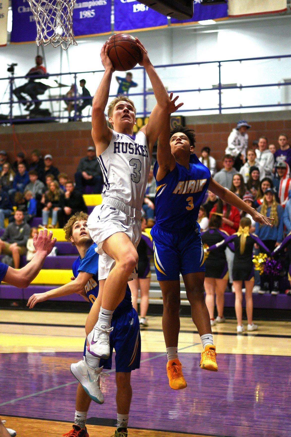 North Fremont's Jordan Lenz rises to the basket.