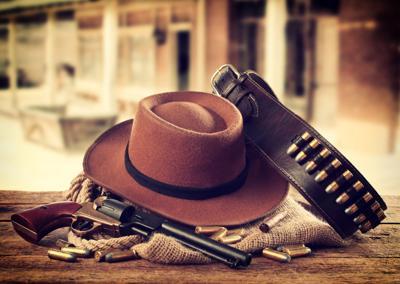 Western style broad brim hat, single shooter gun and belt