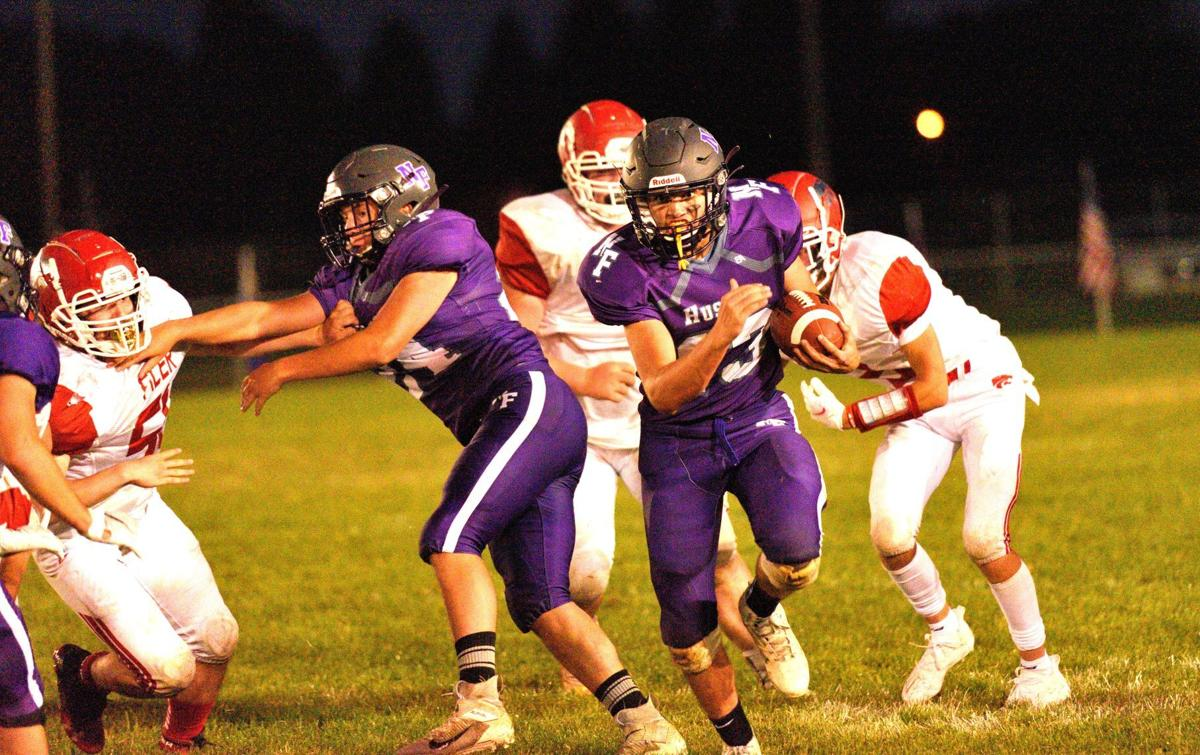 North Fremont quarterback Luke Hill(13) runs to the outside in the Huskies 44-20 win over Filer in their opener Friday.
