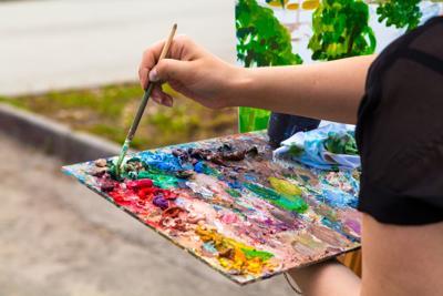 A close-up artist paints