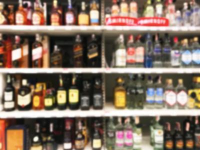 Wine Liquor bottle on shelf blurred background