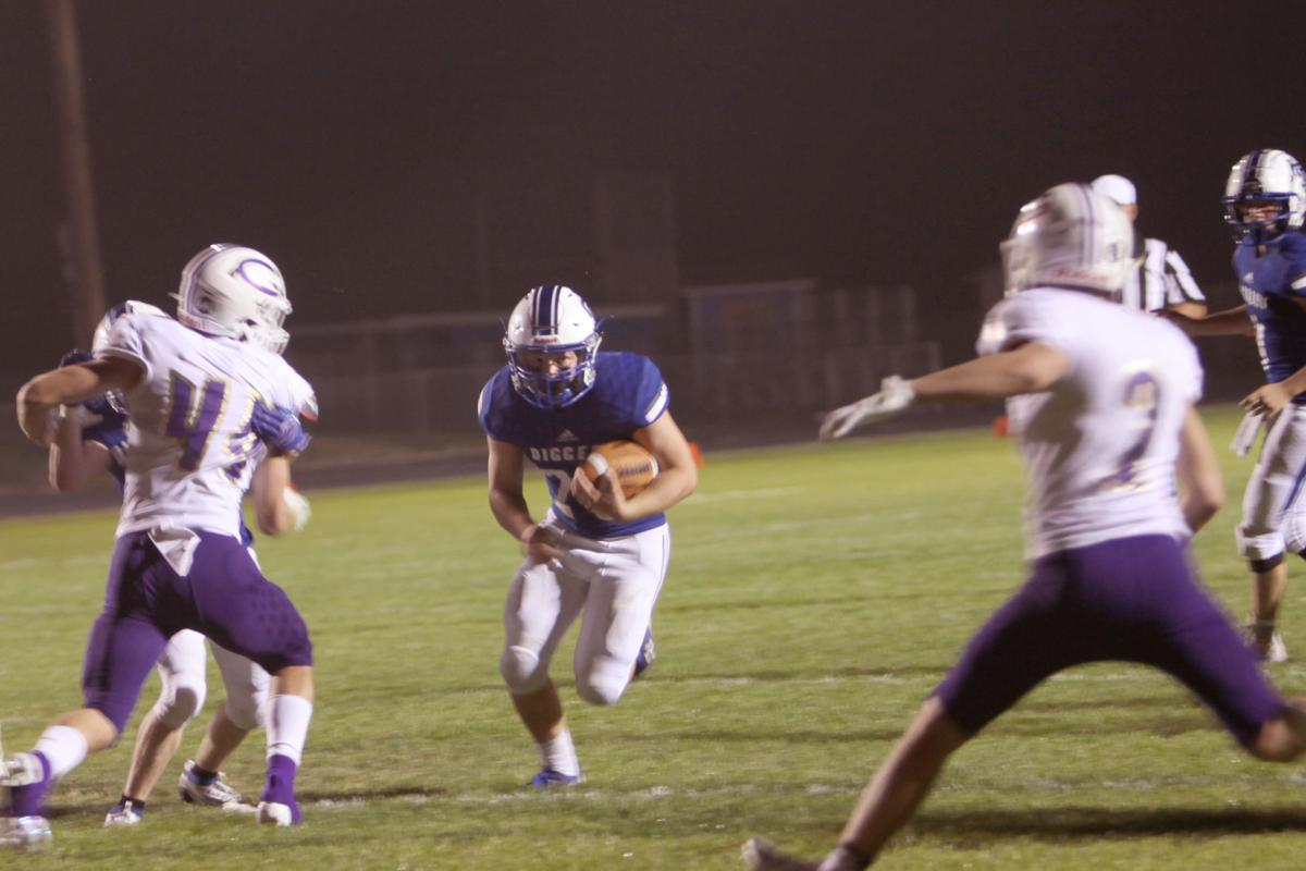 Sugar-Salem's Daxtyn Zollinger runs through an open hole on his way to the endzone for the game-winning score.