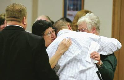 Chris Tapp hugs his mom, Vera Tapp, and Carol Dodge, the mother of murder victim Angie Dodge, after being freed during Wednesday's resentencing hearing at the Bonneville Courthouse. Tapp is free after serving 20 years in prison for the 1996 murder of 18-year-old Angie Dodge.  Taylor Carpenter / tcarpenter@postregister.com