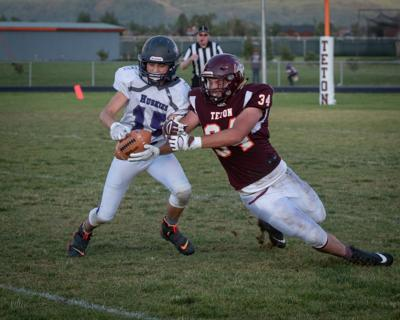 North Fremont's Kohl Nielson snags an interception from a Teton player.