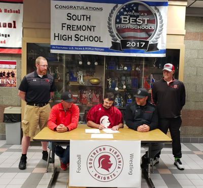 Olson signs his letter of intent at South Fremont high school.