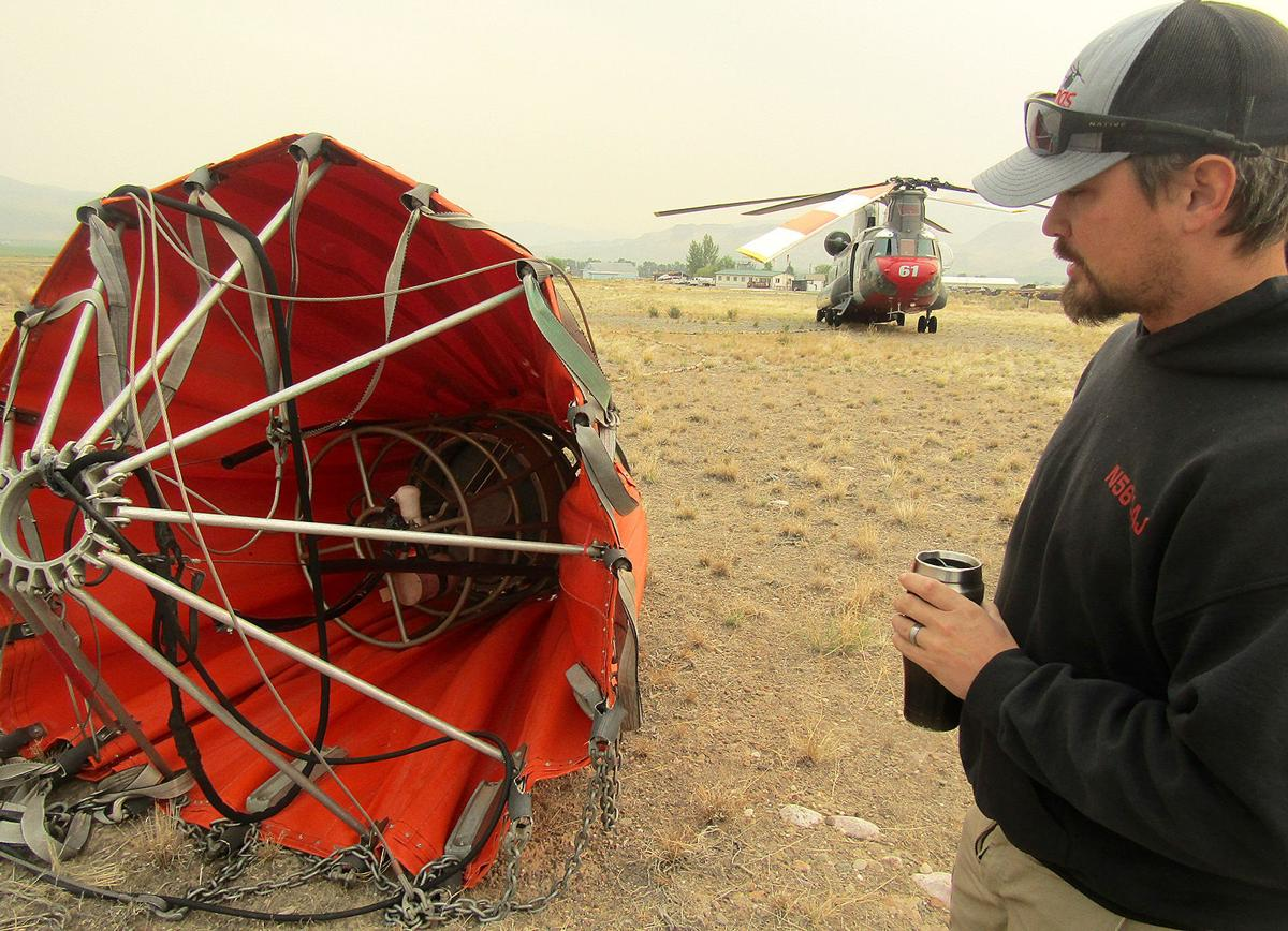 Vietnam-era helicopter brings rain to fires