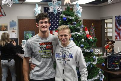 Stacey and Balmforth carry flag for Shelley wrestling