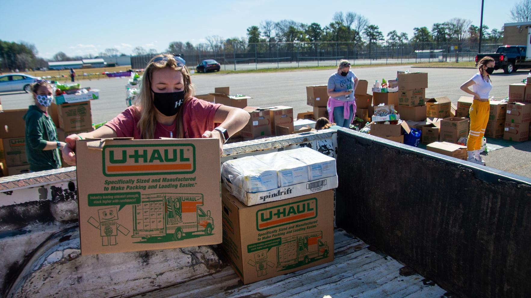 Volunteers hand out nearly 16,000 pounds of food at Hudson Falls High School