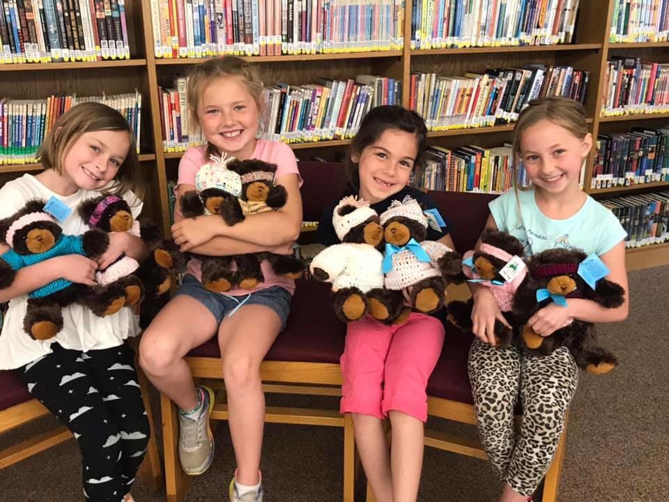 Fort Ann children give 'bear hugs'