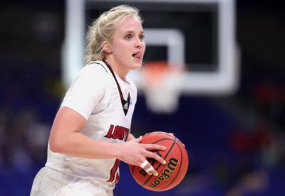 Hailey Van Lith #10 of the Louisville Cardinals looks to pass during the second half against the Oregon Ducks in the Sweet Sixteen round of the NCAA Women's Basketball Tournament at the Alamodome on March 28, 2021, in San Antonio, Texas.