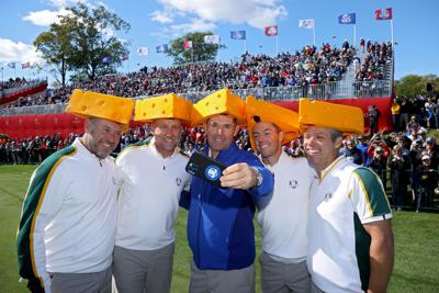 From left, Team Europe's Lee Westwood, Ian Poulter, captain Padraig Harrington, Rory McIlroy and Paul Casey all don cheese head hats during a practice round prior to the 43rd Ryder Cup at Whistling Straits on Wednesday, Sept. 22, 2021, in Kohler, Wis..