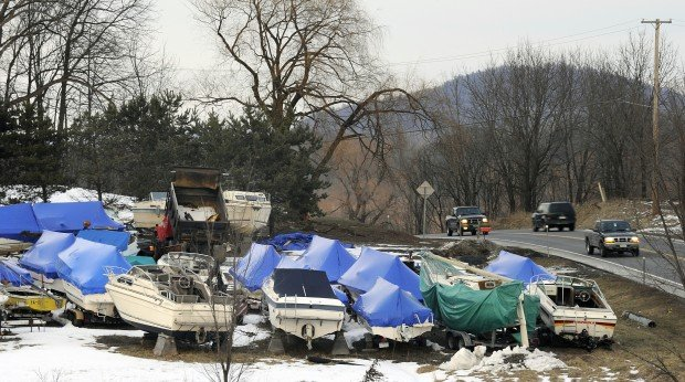 Town wants couple to clear hundreds of boats from property for Outboard motor salvage yard