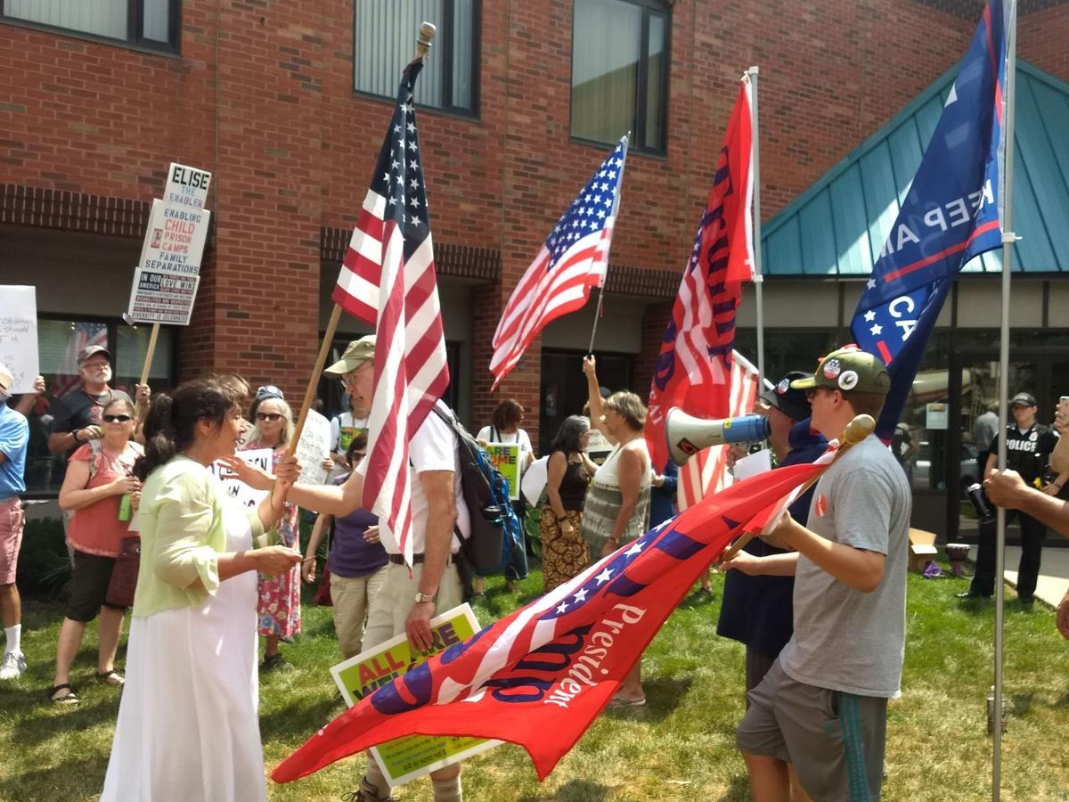 Protesters and counterprotesters demonstrate outside Stefanik's office