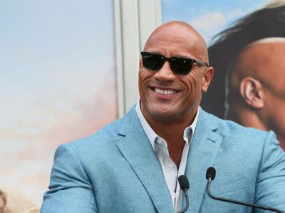 Dwayne Johnson attends a Hand and Footprint ceremony honoring Kevin Hart at the TCL Chinese Theatre IMAX on December 10, 2019 in Hollywood, Ca.