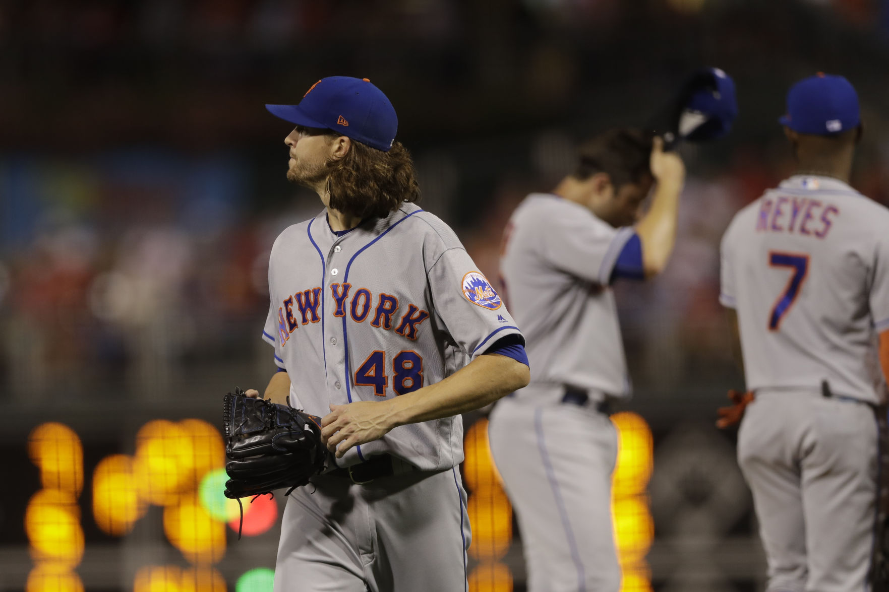 Jacob deGrom exits game after being hit with liner