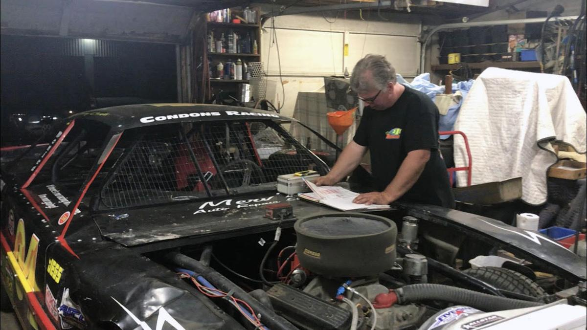 Condon working on car