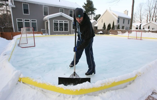Ice by the yard families enjoy skating on homemade rinks for Home zamboni