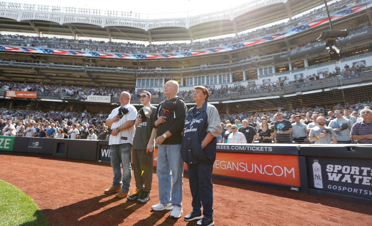 Keith Bishop being honored for his service in April during the 7th inning stretch at Yankee Stadium. From left to right, Scott Bishop, Mason Bishop, Keith Bishop, and Mary Bishop.jpg