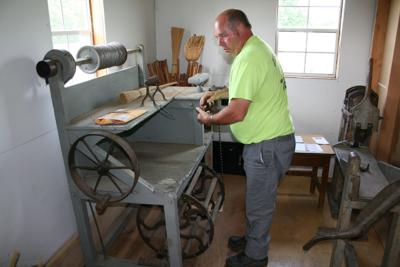 Bruce Caza and broom making machine