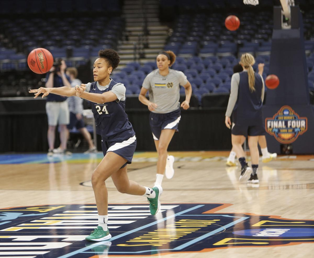Notre Dame's Mikayla Vaughn passes during drills in practice ahead of the NCAA Tournament's Final Four at the Amalie Arena in Tampa, Fla., on Thursday, April 4, 2019.