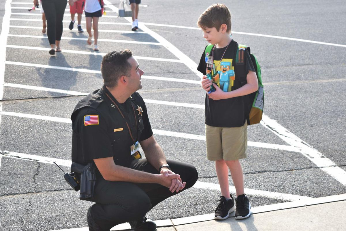 Schools hire resource officers to provide safety, build relationships with students