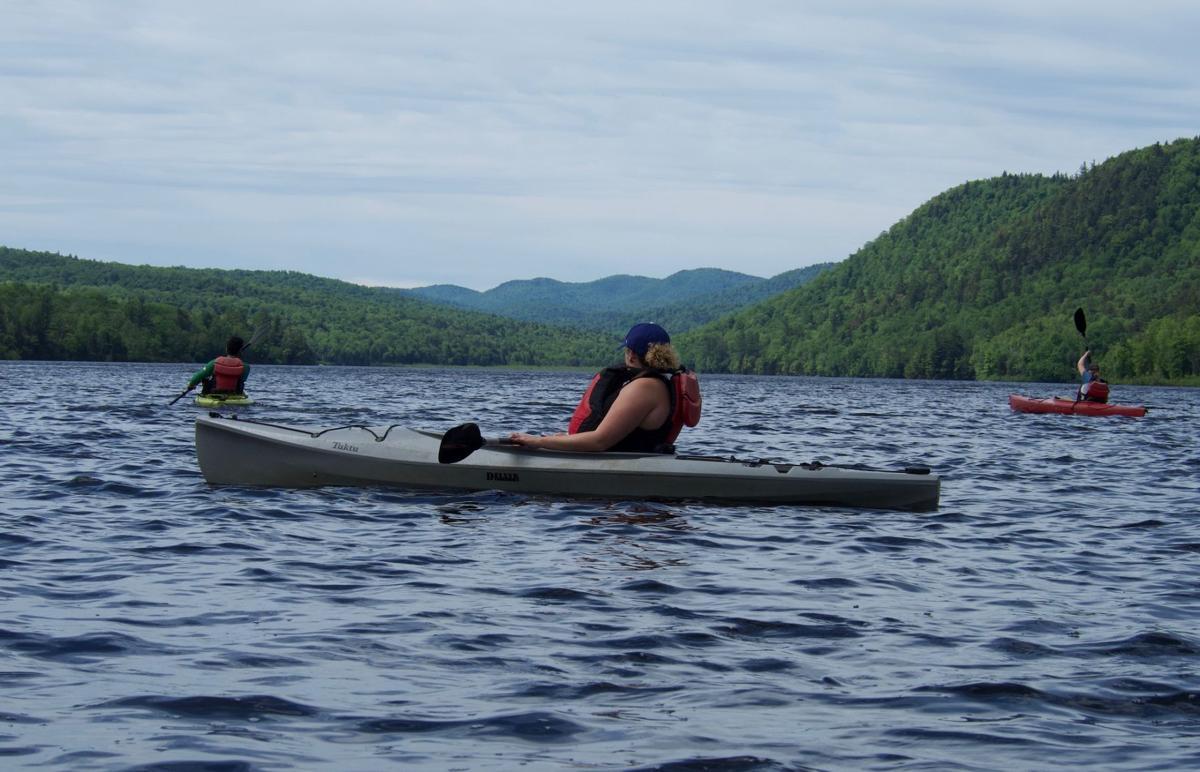 Kayakers paddle on Thirteenth Lake