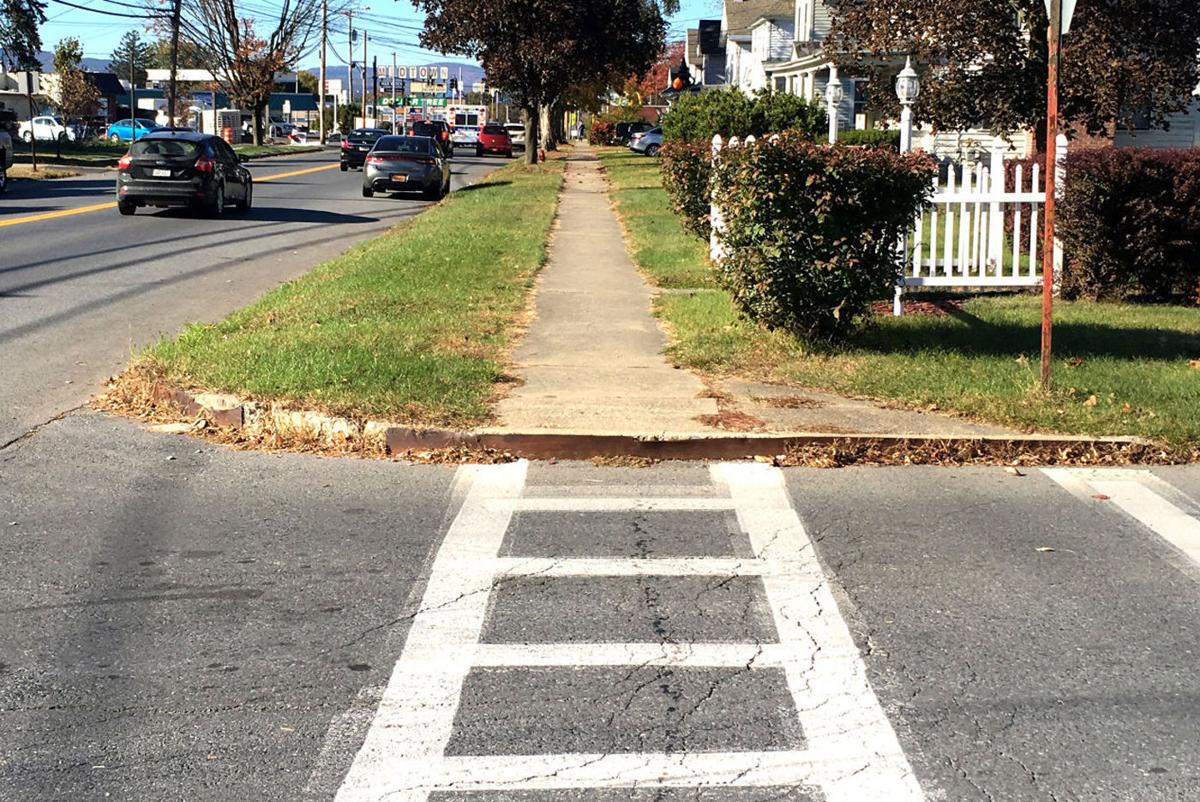 Village, citizens share sidewalk costs