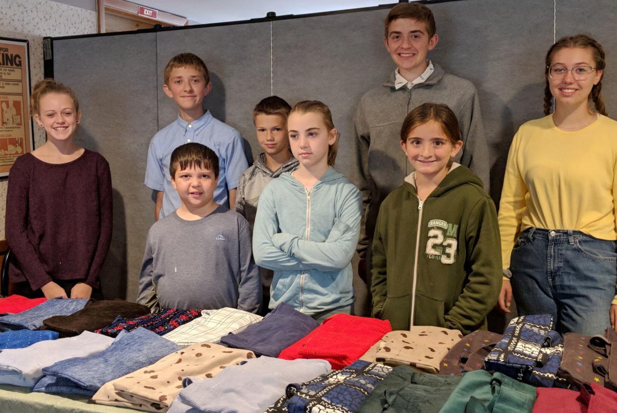 Church kids donate school supplies