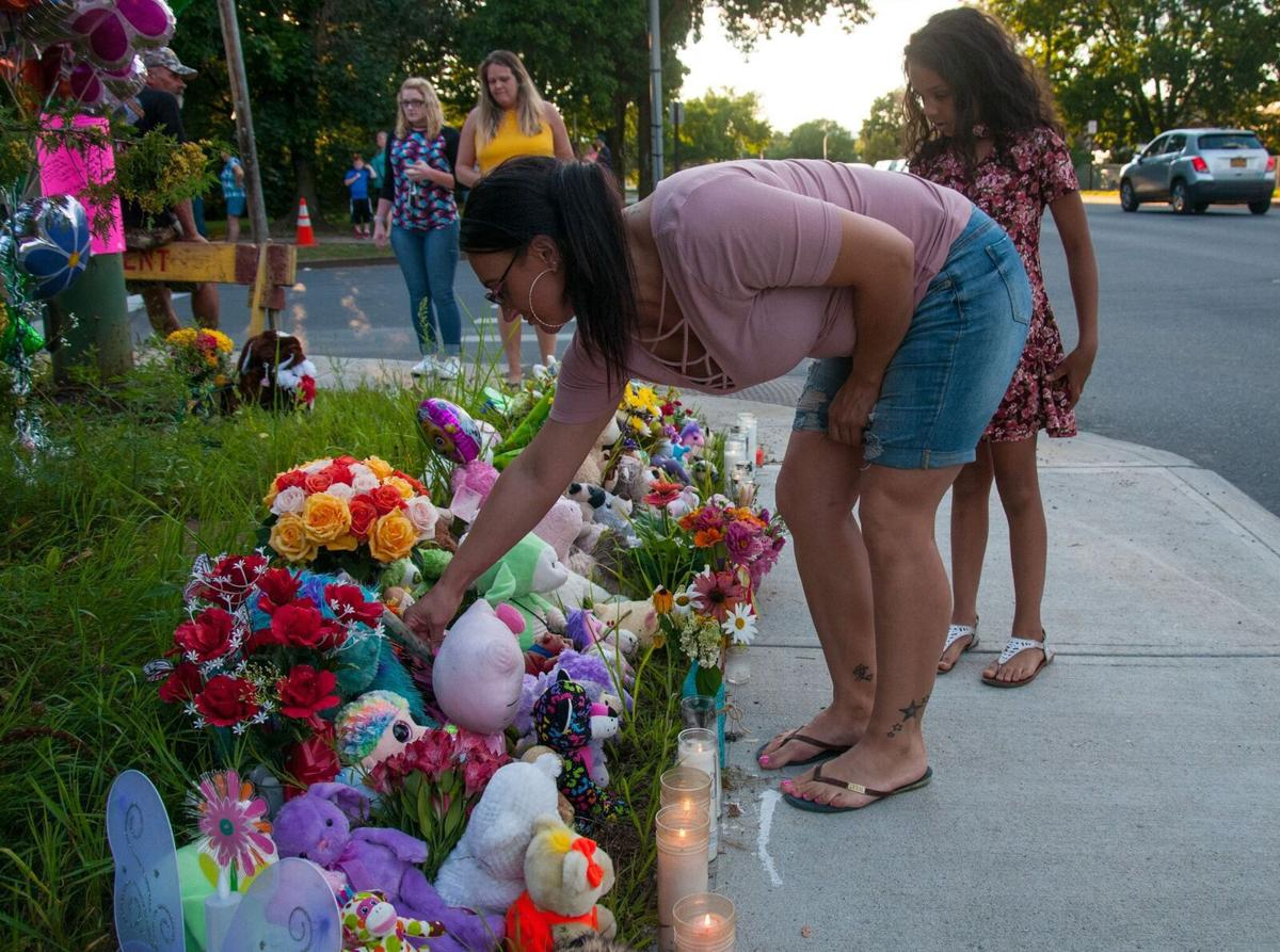 Vigil honors mother and daughter killed on Friday