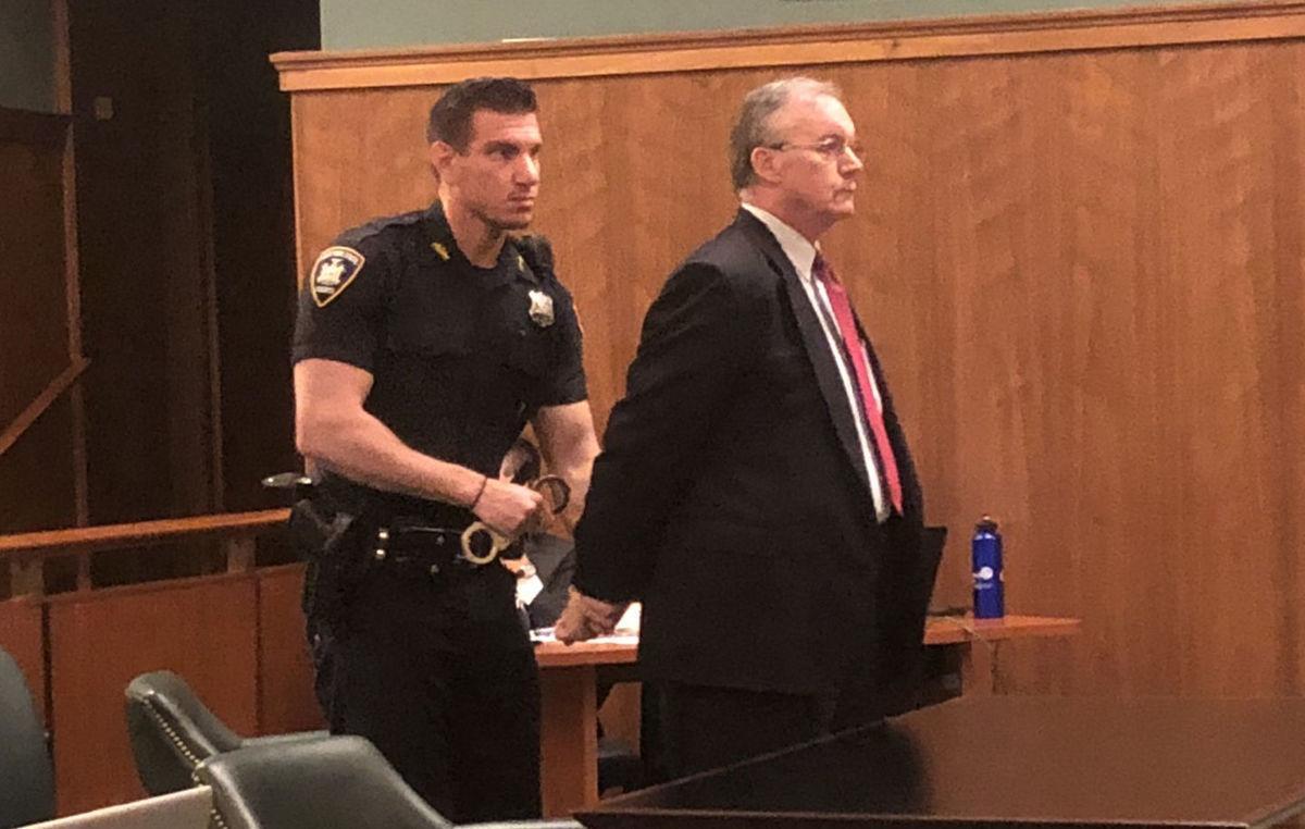 David Decker handcuffed