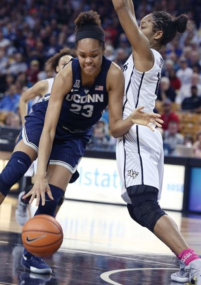 Connecticut's Azura Stevens (23) drives against UCF's Nyala Shuler at CFE Arena in Orlando, Fla., on February 7, 2018.
