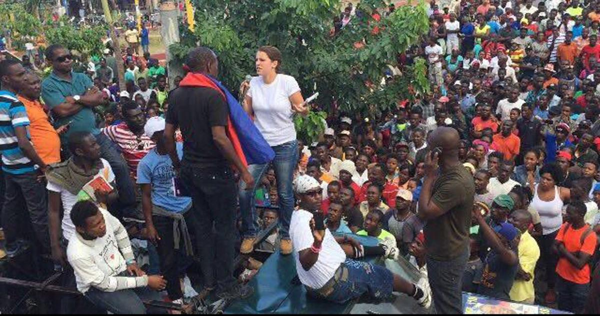 Local woman speaks to Haitian protesters