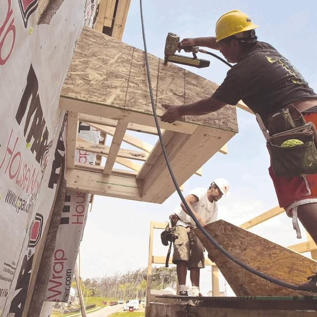 Home sales rise as unemployment claims fall