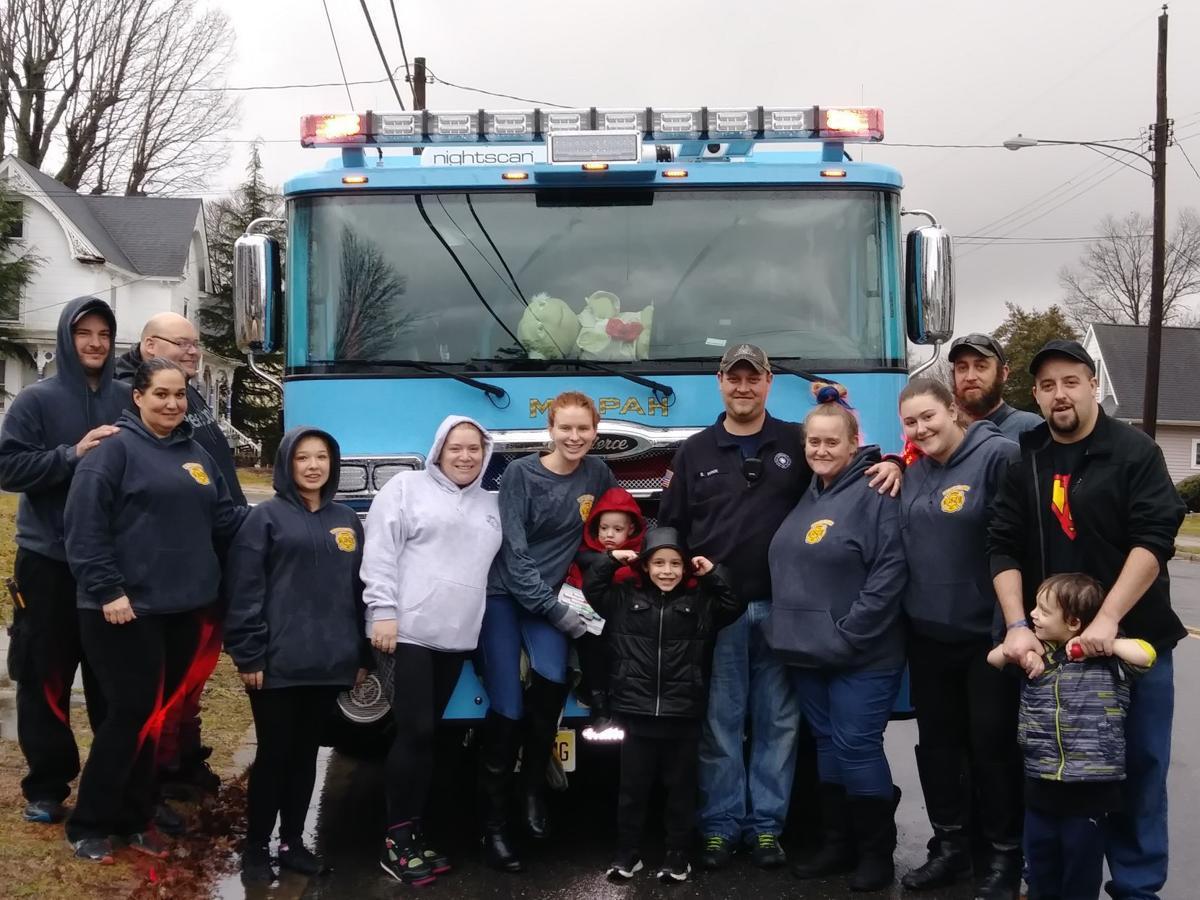 Mizpah Fire Co  names Elmer boy honorary firefighter