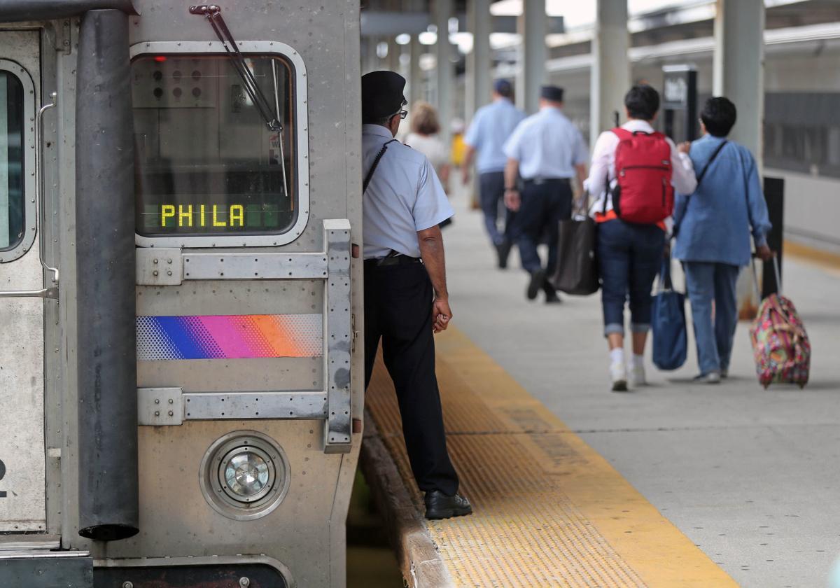 NJ Transit Executive Director Kevin Corbett talk with A.C. rail commuters