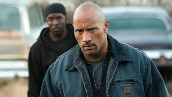 Movie review: The Rock's inexperience helps sell 'Snitch'