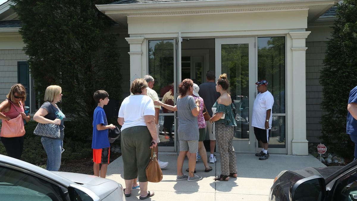 Patients line up to get records as Dr. James Kauffman's office closes