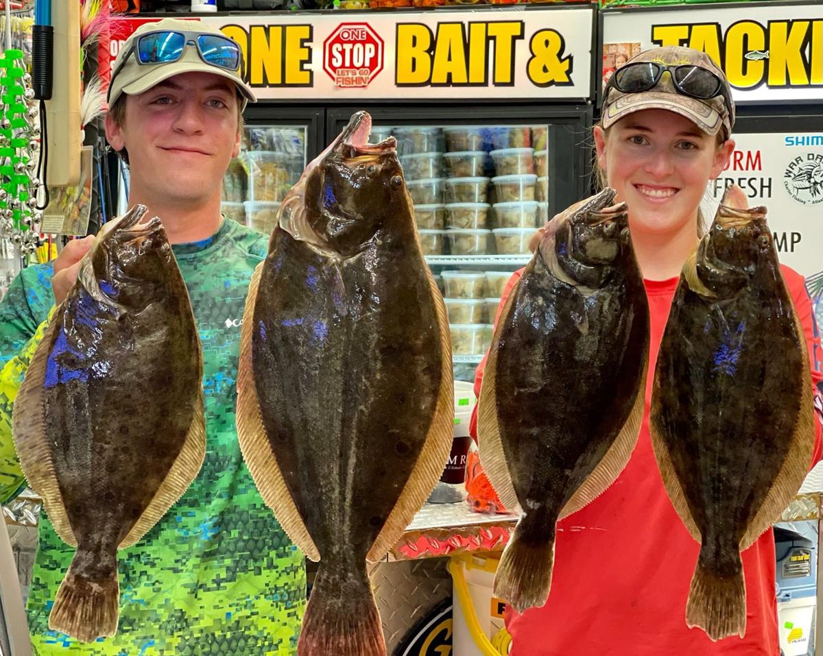 Brian Houf and Ashley Emmel with flounder