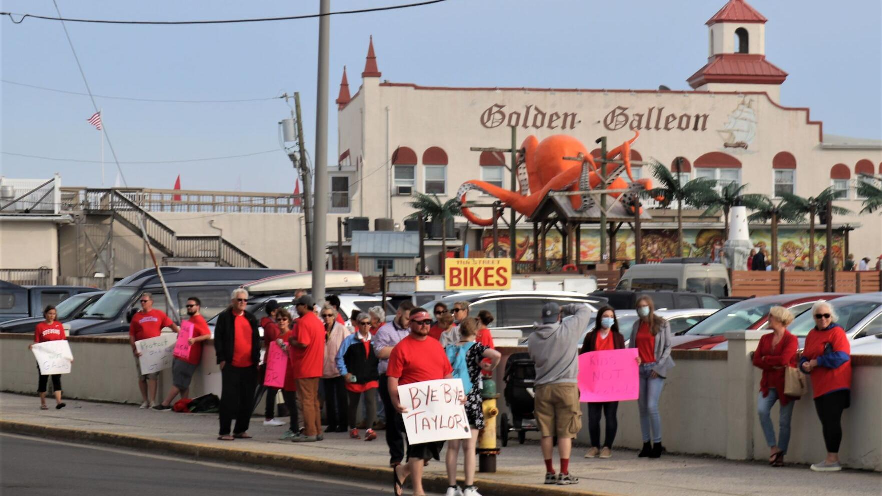 As Ocean City celebrates outgoing superintendent, protesters have their say