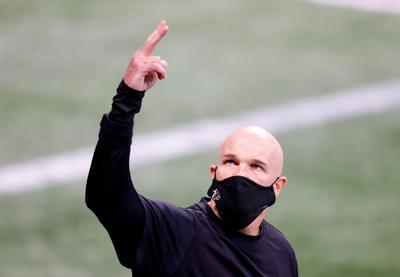 Head coach Dan Quinn of the Atlanta Falcons walks out on the field during pregame warmups prior to facing the Carolina Panthers at Mercedes-Benz Stadium on Oct. 11, 2020 in Atlanta, Georgia.