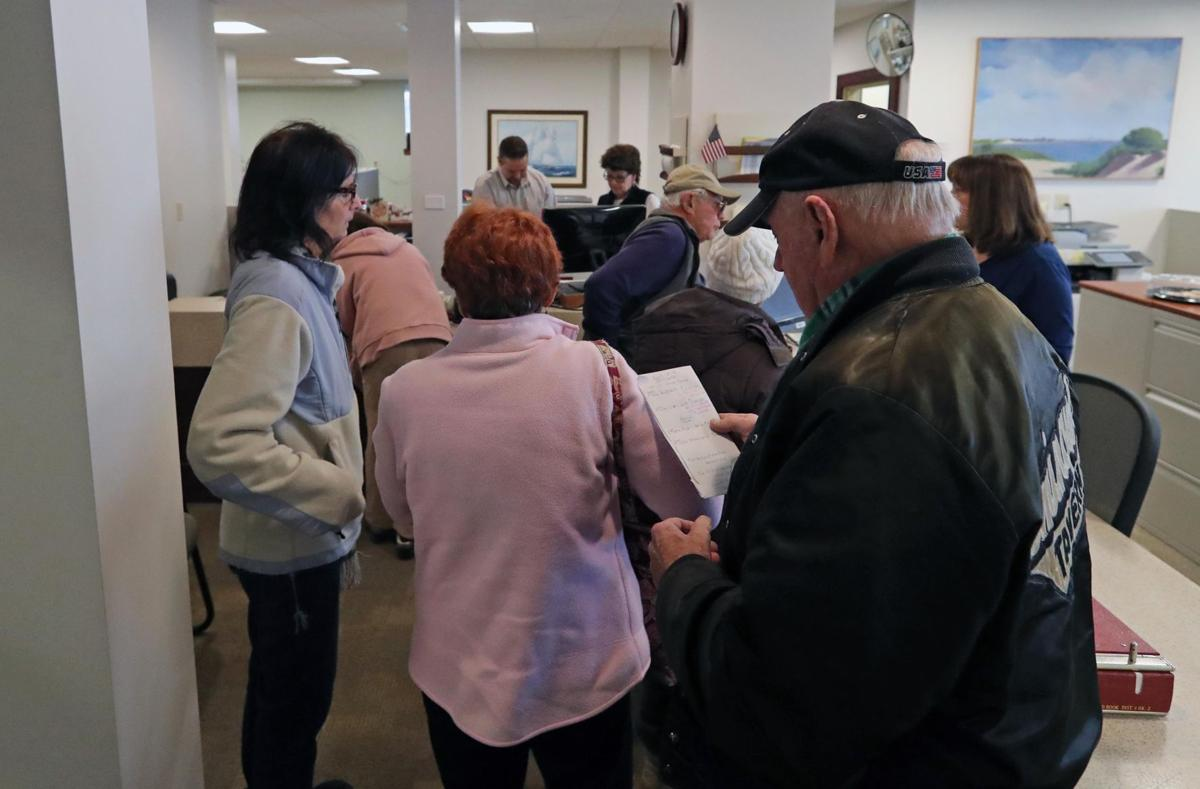 People rush to pay taxes before Jan. 1