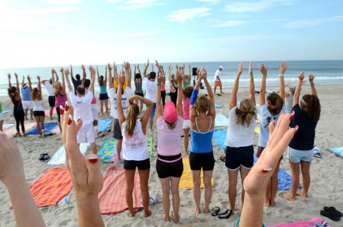 Mass beach yoga demonstration in Longport benefits ovarian cancer