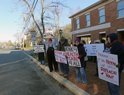 Local activists rally outside to vote no