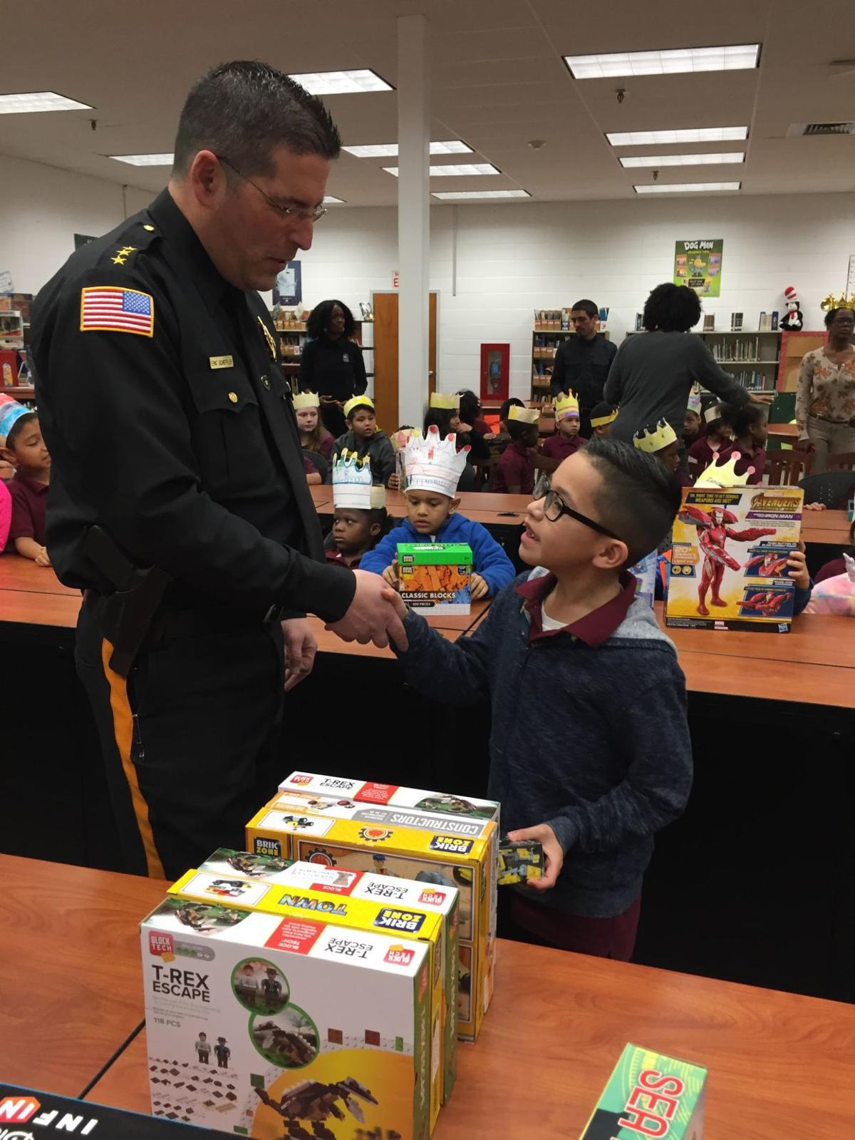 Jeyren Juarez-Herrera, a 2nd grader at North Main Street School thanks Sheriff Eric Scheffler for his toy received at the 3 Kings Day Celebration.JPG