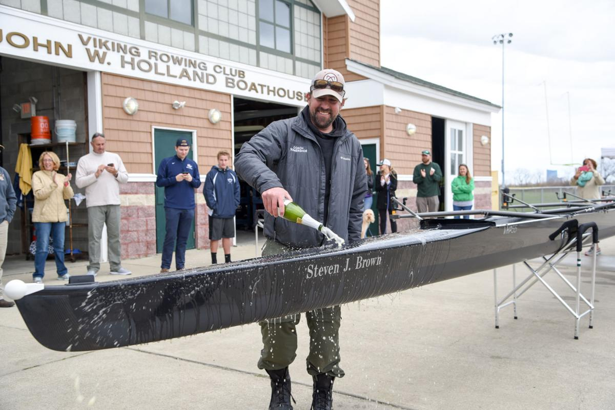 Mainland Crew Eric Somershoe, from Ventnor, christens a new crew boat dedicated to former Mainland Crew Coach Steven J. Brown during the First Annual Back Bay Challenge held at the Dr. John W. Holland Boathouse in Ventnor. Dave Griffin / for the Press