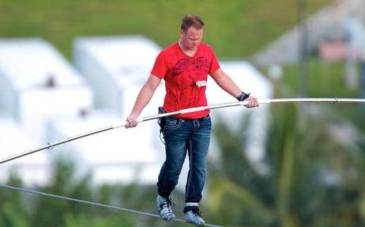 Nik Wallenda performing high-flying stunts in A.C.