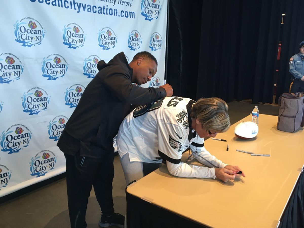 Sproles signs jersey for local fan
